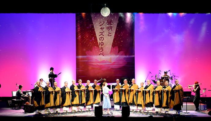 "Photo: A disco ball lights up the concert hall as Buddhist priests join a jazz band in performing ""Itsumo Nando-demo"" from Spirited Away"